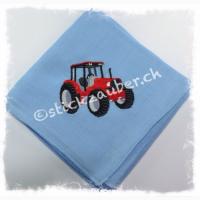 Traktor rot auf hellblau